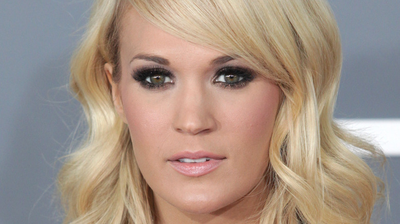 Carrie Underwood with a neutral expression