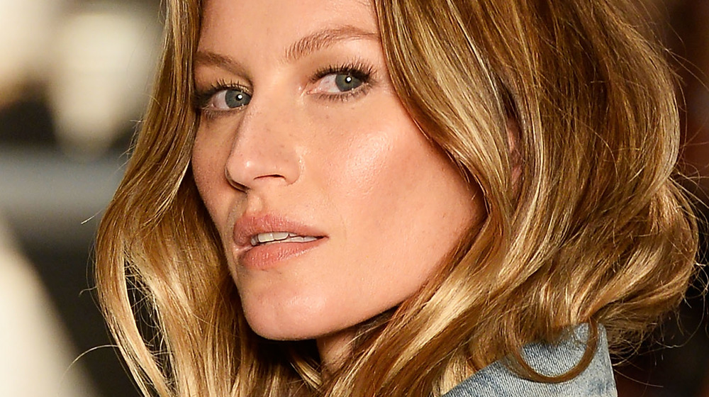 Gisele Bundchen casting a look to the side