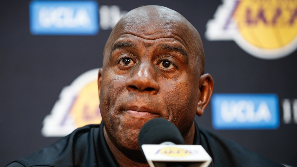 Earvin Magic Johnson at a microphone, sitting