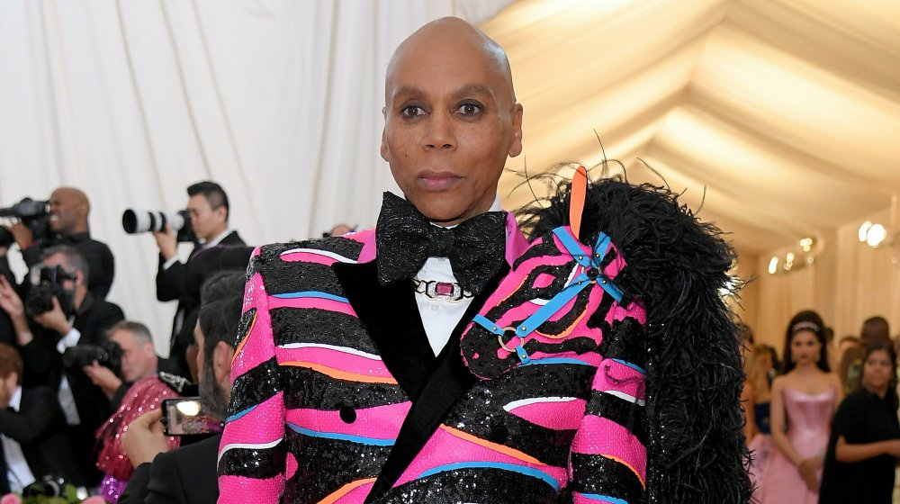 RuPaul in a sequinned black and pink blazer