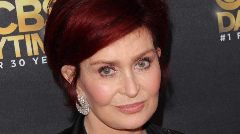 Sharon Osbourne smirking