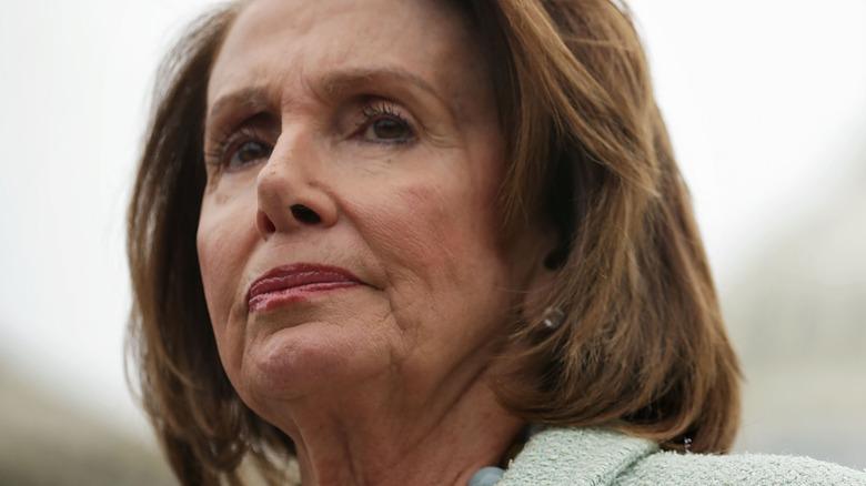 Nancy Pelosi in a pink suit