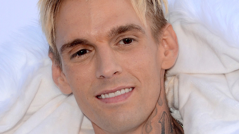 Aaron Carter neck tattoo smiling blond