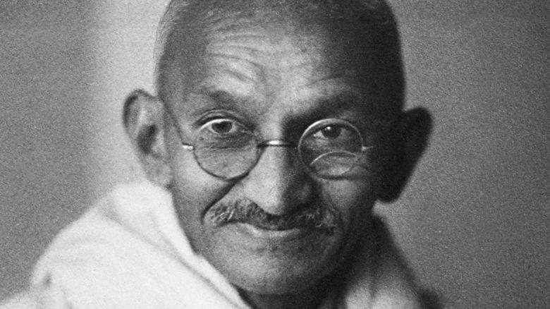 Mahatma Gandhi looking on