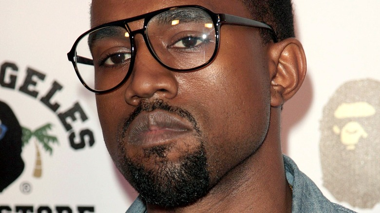 Kanye West wearing glasses