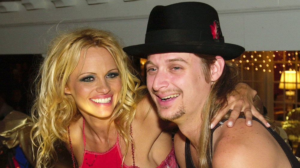 Pamela Anderson and Kid Rock laughing