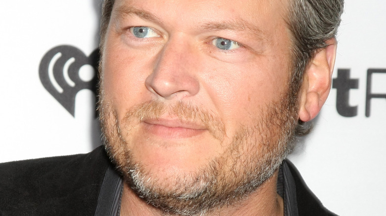 Blake Shelton with a neutral expression