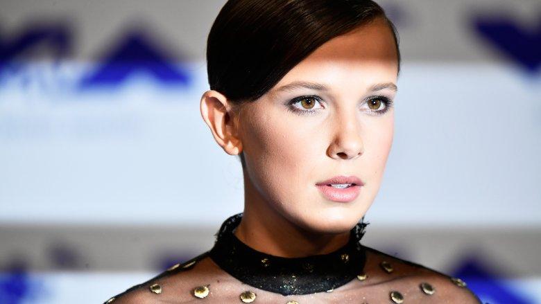 Millie Bobby Brown with slicked back hair