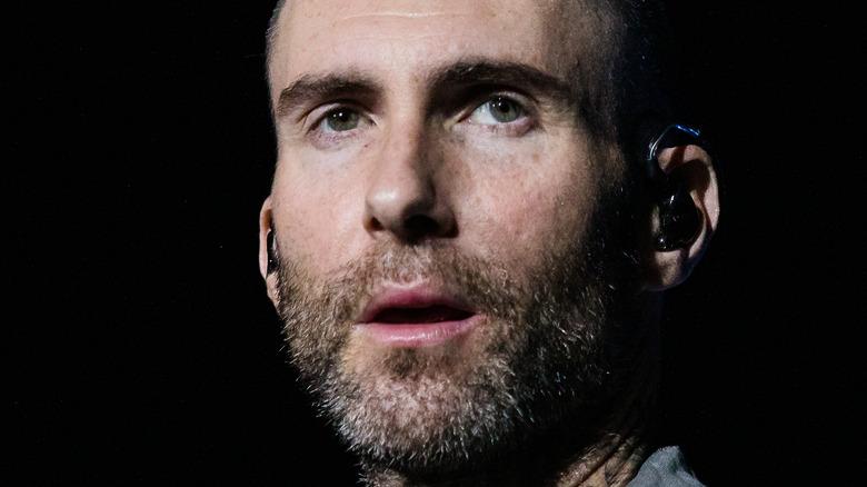 Adam Levine stares off into the distance
