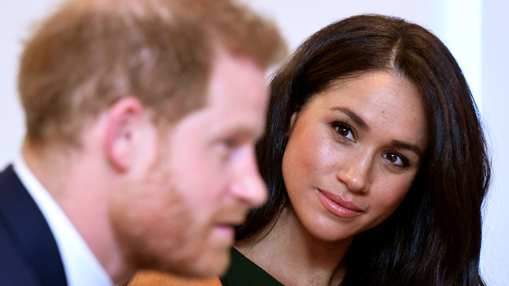 Meghan Markle looking at Prince Harry during an event