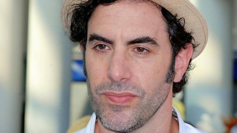 Sacha Baron Cohen in tan fedora