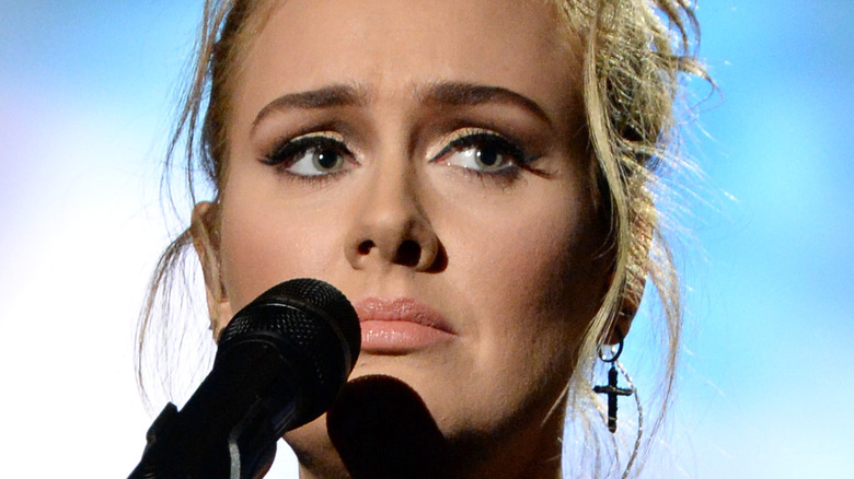 Adele holding microphone