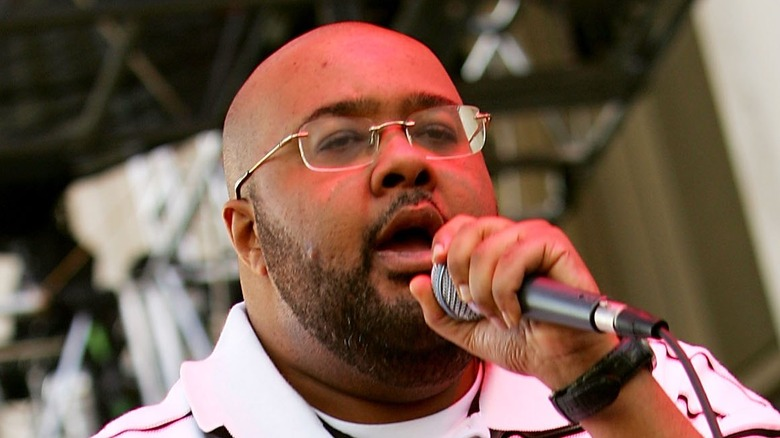 Gift of Gab, bald, with facial hair, performing on stage  in 2006