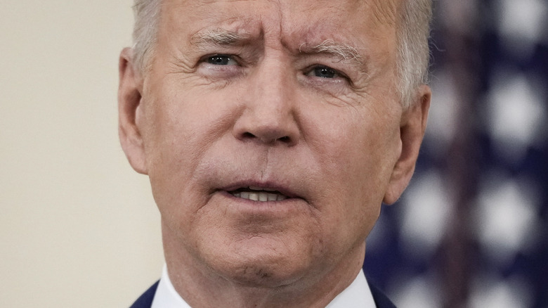 President Joe Biden speaking with serious expression