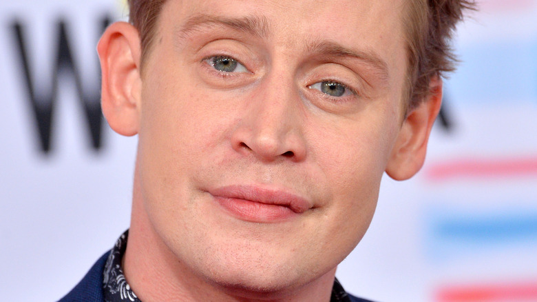 Macaulay Culkin poses on the red carpet