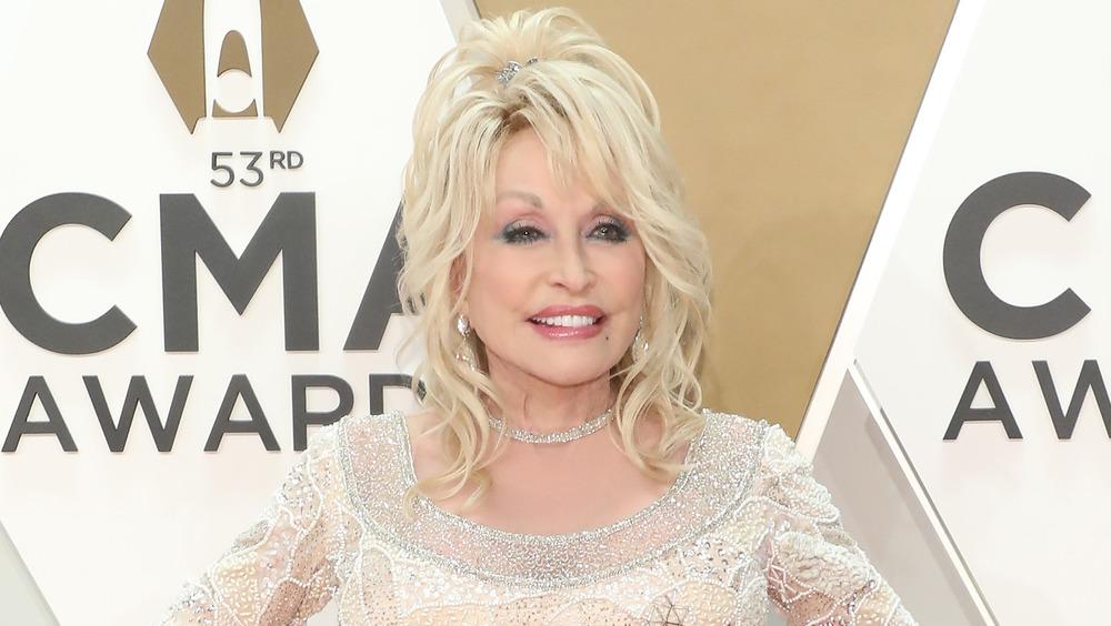 Dolly Parton posing on the red carpet