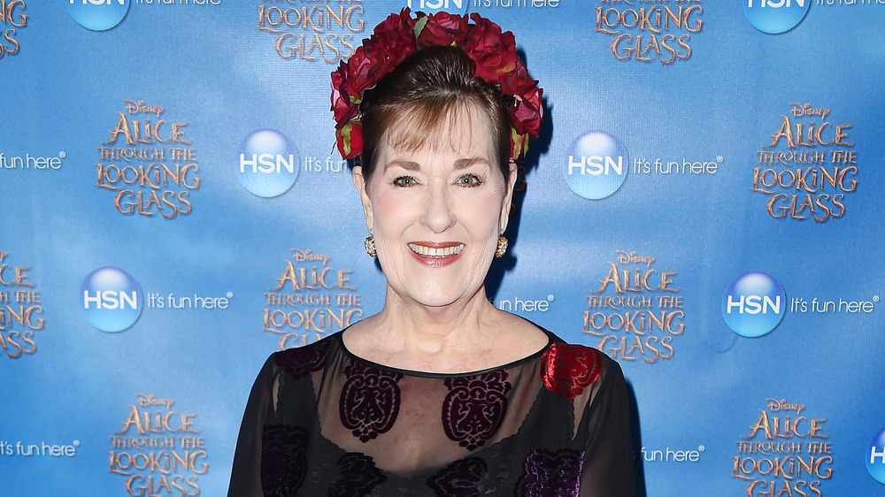 Kerry Vincent with flowers in her hair on the red carpet