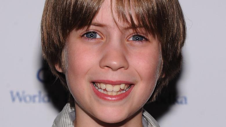 Matthew Mindler smiles at movie premiere in 2011