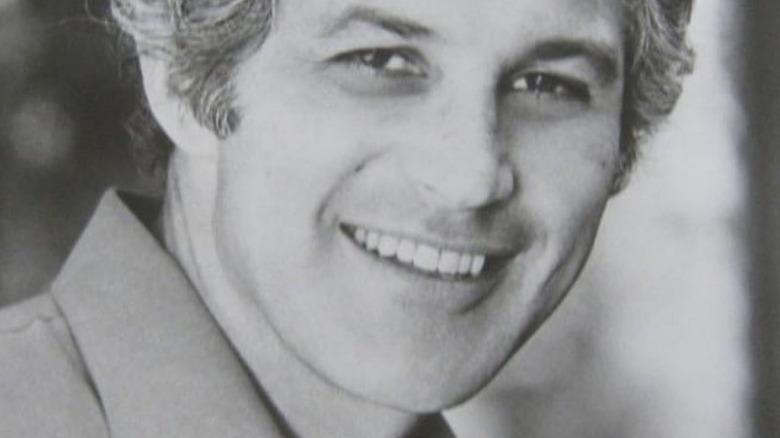 John Gabriel smiling for headshot