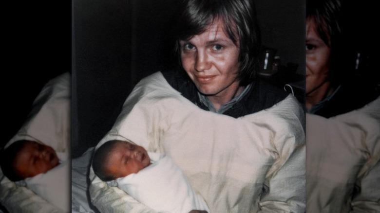 Polaroid of Jon Voight holding baby Angelina Jolie
