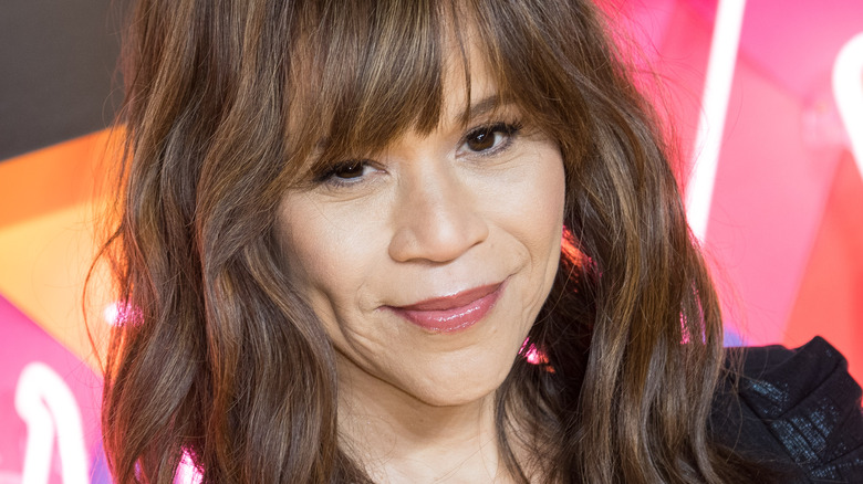 Rosie Perez posing with a small smile