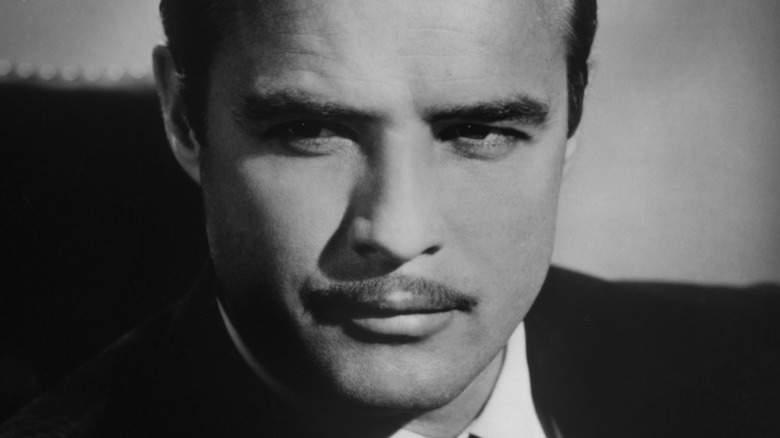 Marlon Brando posing with mustache