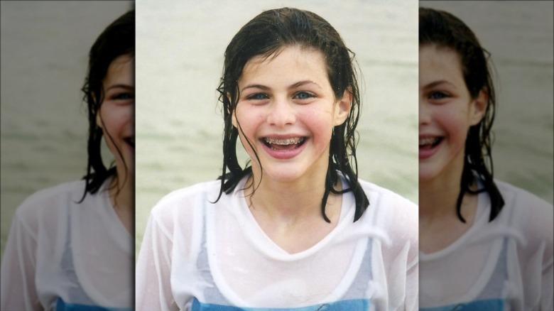 Alexandra Daddario in the ocean as a child