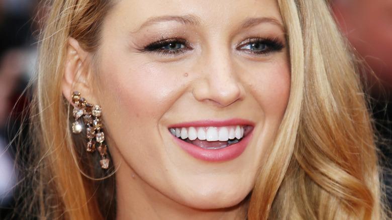 Blake Lively smiling on the red carpet