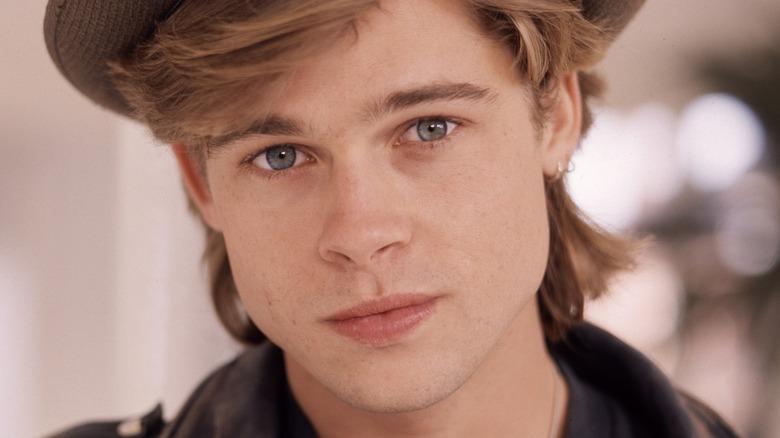 Headshot of Brad Pitt in a hat