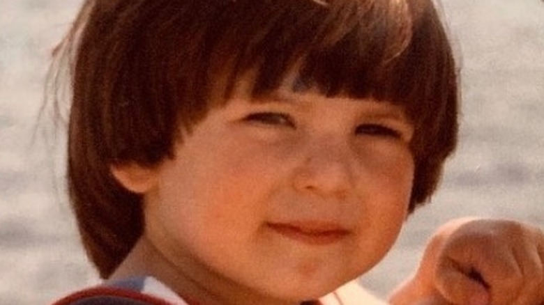 Young Chris Evans grinning