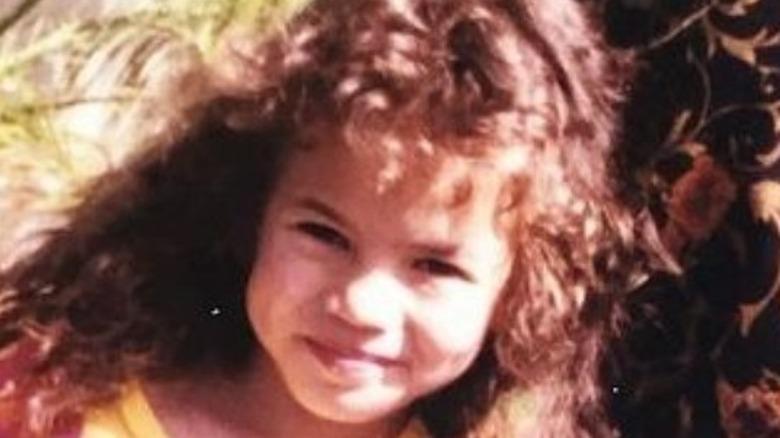 Child Chrissy Teigen smiling