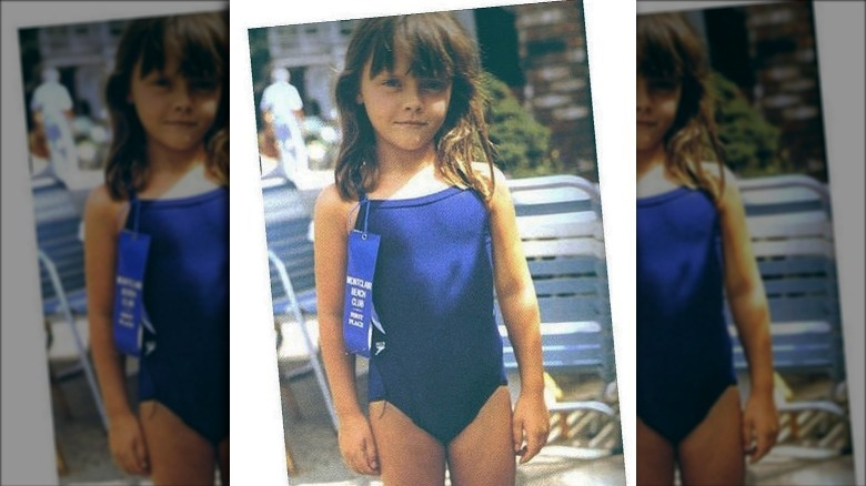 Christina Ricci as a child in a blue swimsuit