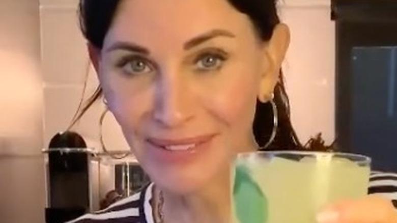 Courteney Cox with a margarita