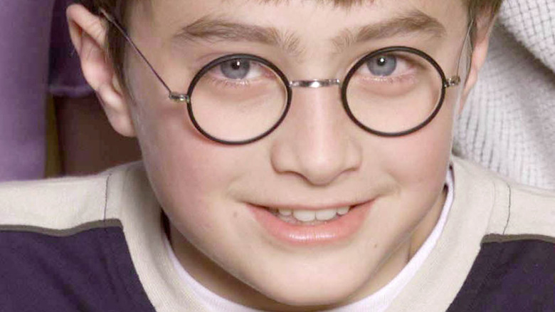 Daniel Radcliffe at age 11 wearing glasses and smiling