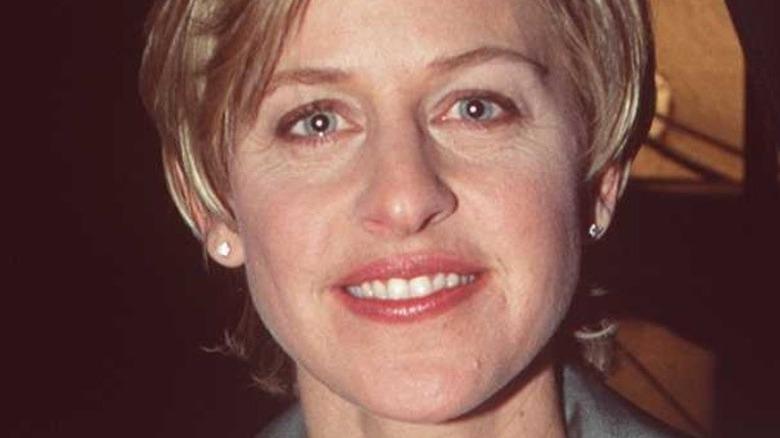 Ellen DeGeneres poses in a lavender suit in 1996