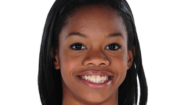 Teenage Gabby Douglas smiling