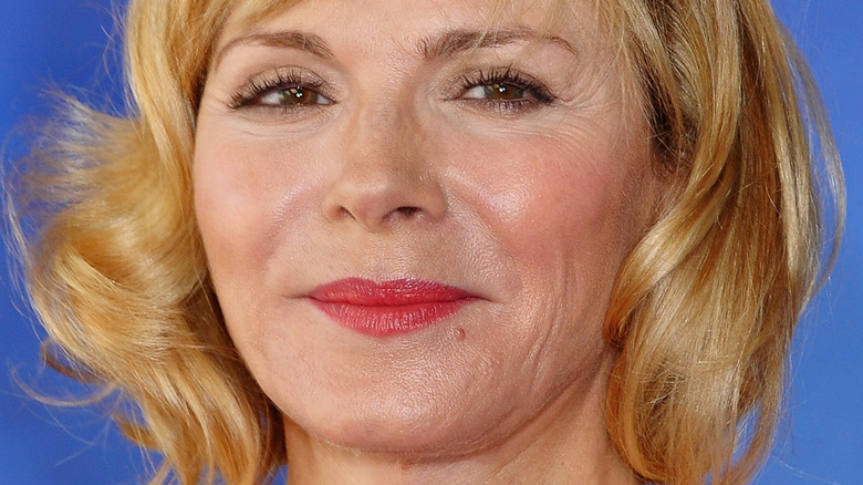 Kim Cattrall poses in a red lipstick