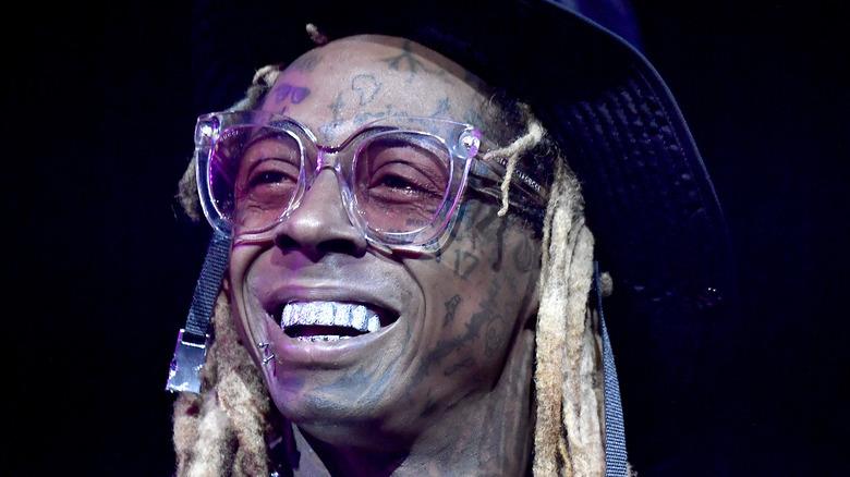 Lil Wayne smiling on stage