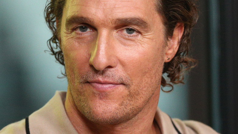 Matthew McConaughey poses in beige shirt