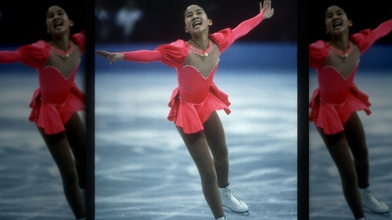 Michelle Kwan smiles while skating