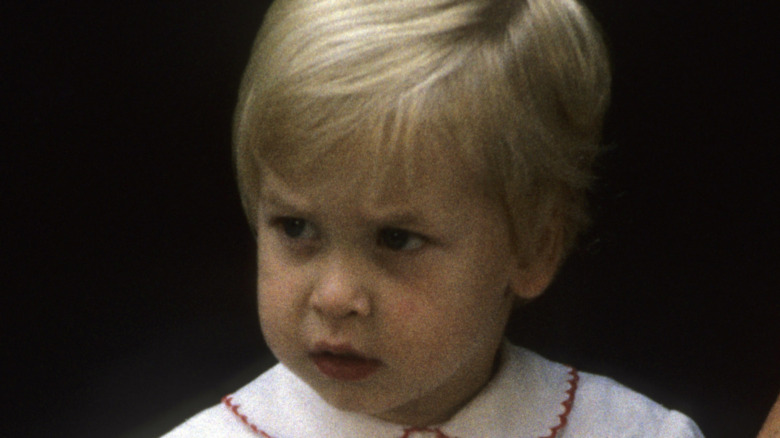 A young Prince William playing outside