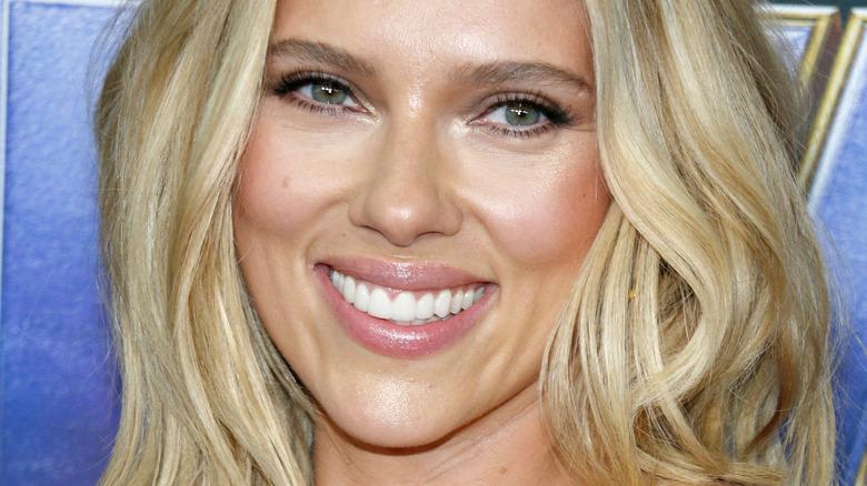 Scarlett Johansson smiles on the red carpet