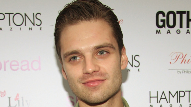 Young Sebastian Stan smirking