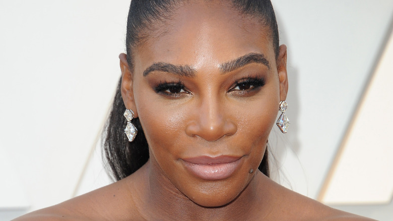 Serena Williams, 2019 photo, wearing makeup, hair up in pony tail
