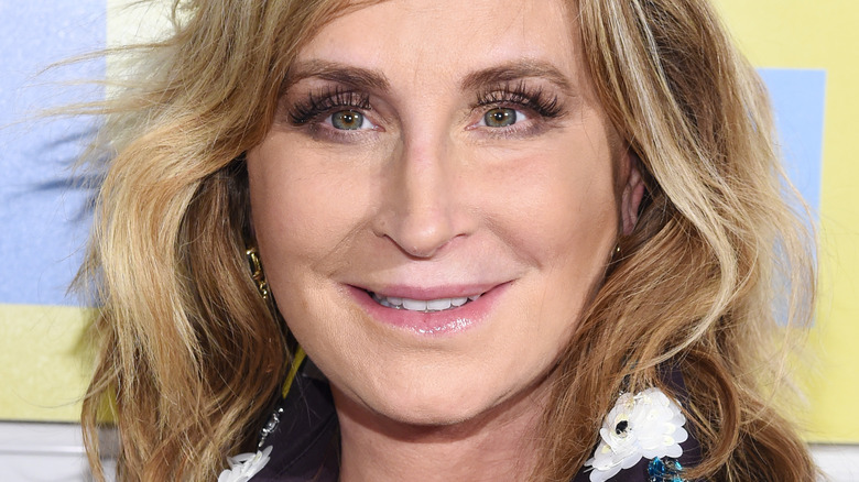 Sonja Morgan smiling with wavy hair