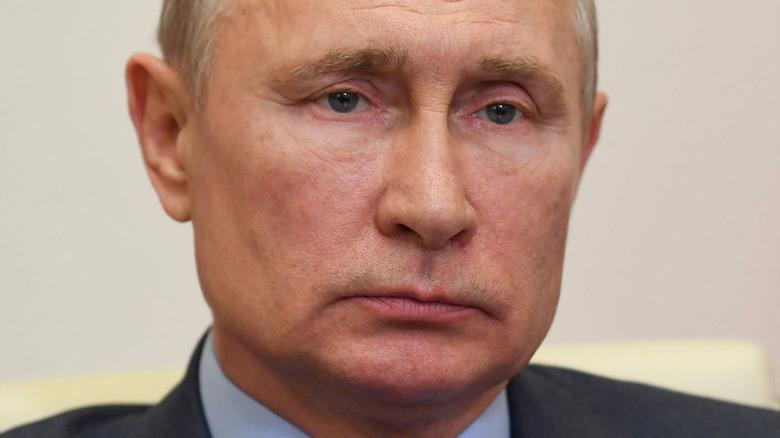 Vladimir Putin wearing a dark gray suit