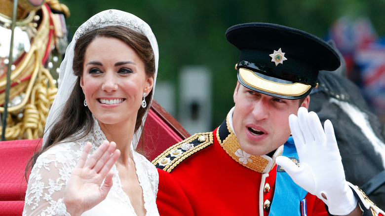 Kate Middleton and Prince William waving on their wedding day