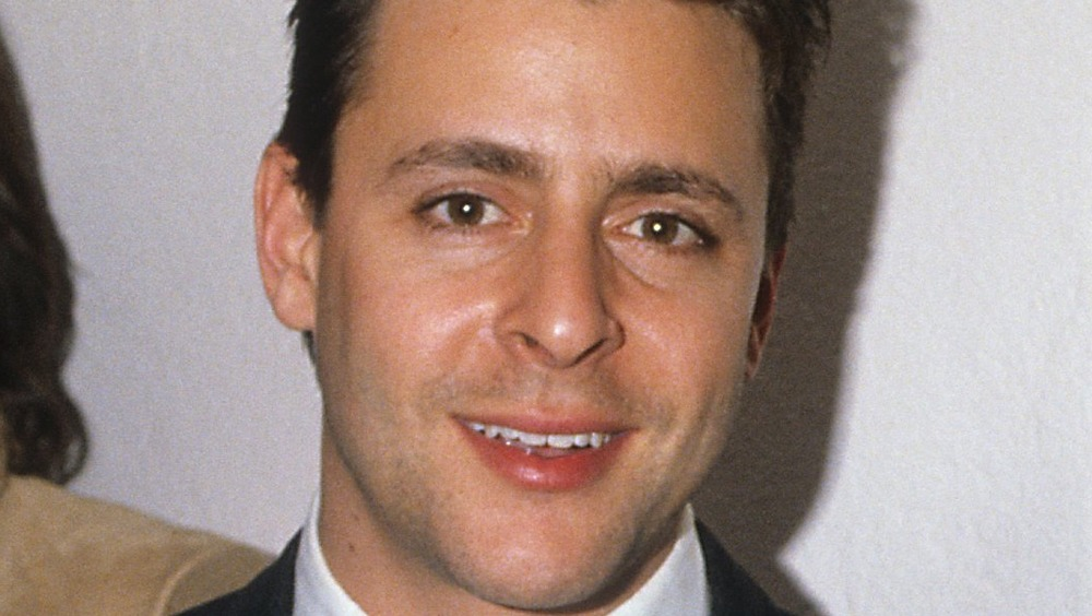 young Judd Nelson smiling