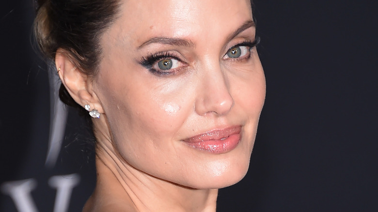 Angelina Jolie smiling on red carpet at Maleficent premiere
