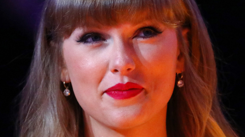 Taylor Swift subtly smiles at the camera